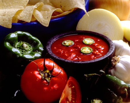 chips and salsa: Bowl of salsa with chips and vegetables