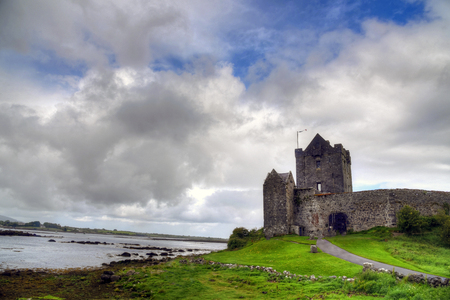 irish culture: KINVARA, COUNTY GALWAY, IRELAND - JUNE 4, 2017 - The ruins of Dunguaire Castle.