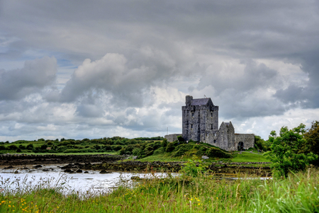 KINVARA, COUNTY GALWAY, IRELAND - JUNE 4, 2017 - The ruins of Dunguaire Castle.