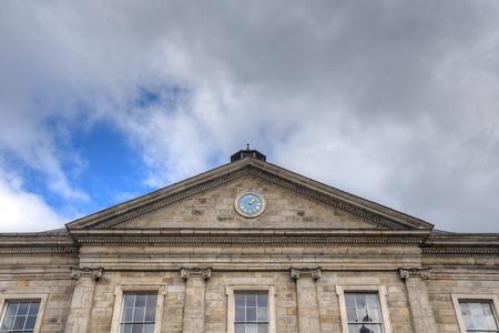 Dublin, Ireland - May 29, 2017: The courtyard of Trinity College and the Campanile of Trinity College in Dublin, Ireland on May 29, 2017. Editorial