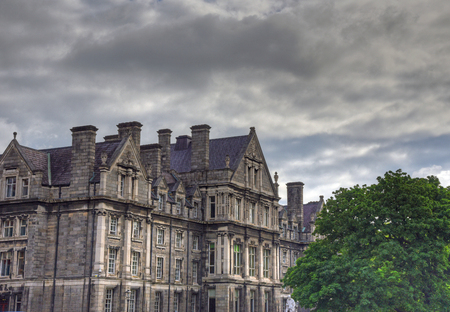 irish culture: Dublin, Ireland - May 29, 2017: The courtyard of Trinity College and the Campanile of Trinity College in Dublin, Ireland on May 29, 2017. Editorial