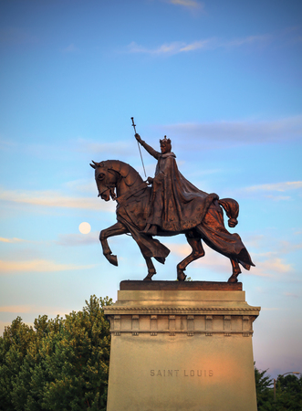 missouri: The moon over the Apotheosis of St. Louis statue of King Louis IX of France, namesake of St. Louis, Missouri in Forest Park, St. Louis, Missouri.