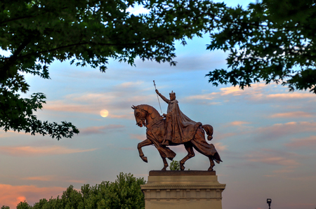 The moon over the Apotheosis of St. Louis statue of King Louis IX of France, namesake of St. Louis, Missouri in Forest Park, St. Louis, Missouri.