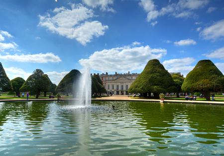 East Molesey, UK - May 26, 2015 - A view of Hampton Court Palace, a royal palace in the borough of Richmond upon Thames, London, England.