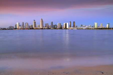 The sunset over the San Diego skyline across San Diego Bay from Coronado Island. Stock Photo