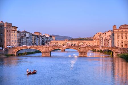 June 6, 2019 - Florence, Italy - A view of the Arno River and the Ponte Vecchio in Florence, Italy.