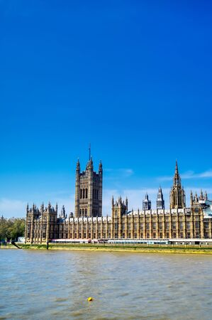 British Parliament along the River Thames on a sunny day in London, UK.