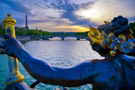 A view from the Pont Alexandre III bridge that spans the Seine River in Paris, France