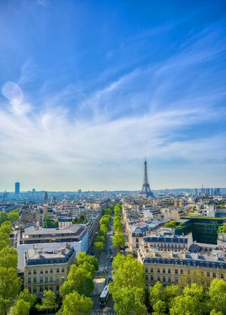 A view of the Eiffel Tower and Paris, France from the Arc de Triomphe.