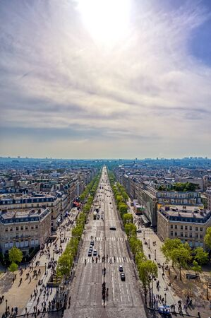 A view of Paris, France from the Arc de Triomphe on a sunny day.