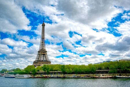 The Eiffel Tower across the River Seine in Paris, France. Фото со стока