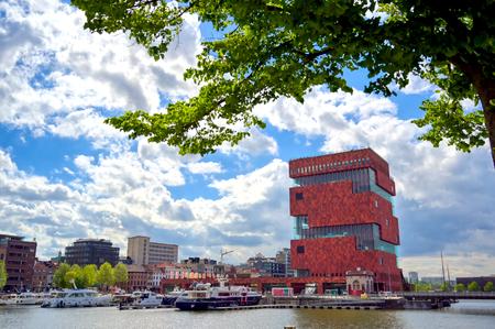 Antwerp, Belgium - April 26, 2019: Museum aan de Stroom (MAS) along the river Scheldt and the Port of Antwerp in Antwerp, Belgium.