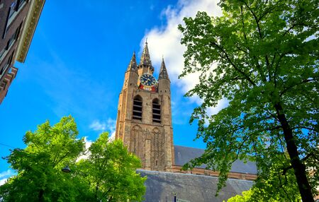 The Oude Kerk (old church) in the city of Delft in The Netherlands on a sunny day.