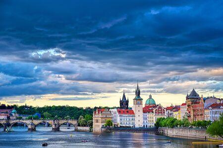 A view of Old Town Prague and the Charles Bridge across the Vltava River in Prague, Czech Republic. Stock fotó