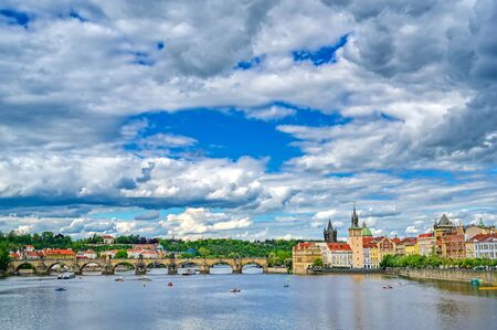 A view of Old Town Prague and the Charles Bridge across the Vltava River in Prague, Czech Republic.