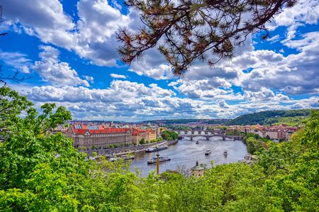 A view of Prague, Czech Republic and the Vltava River from Letna Gardens on a sunny day. Фото со стока