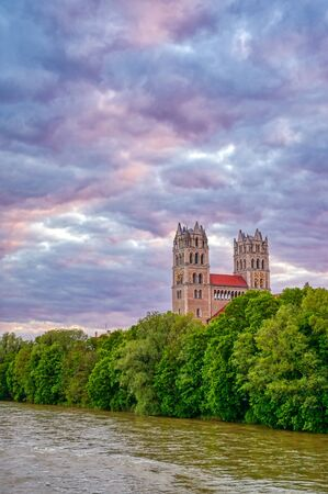 The Church of St. Maximilian along the Isar River at sunset in Munich, Bavaria, Germany.