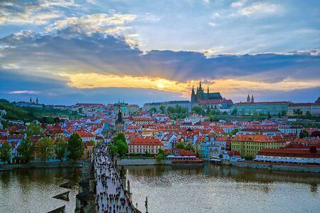 A view of Prague Castle and the Charles Bridge across the Vltava River in Prague, Czech Republic.