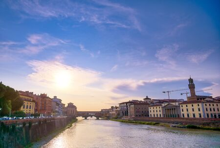 A view along the Arno River towards the Ponte Vecchio in Florence, Italy.