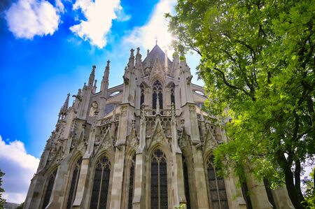 The Votivkirche, or Votive Church, from the streets of Vienna, Austria.