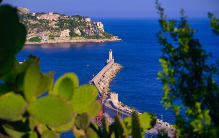 The lighthouse at the Port of Nice on the Mediterranean Sea at Nice, France along the French Riviera. Imagens