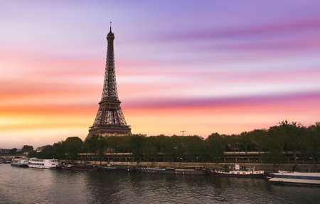 Sunset over the the Eiffel Tower and the Seine River in Paris, France.