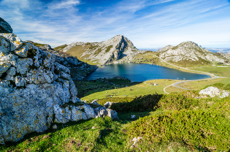 Covadonga lakes, Picos de Europa. Rocks, mountains and water landscape in Asturias, Spain in a sunny day