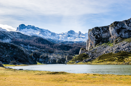 Covadonga lakes, Picos de Europa. Rocks, mountains and water landscape in Asturias, Spain in a sunny day on winter