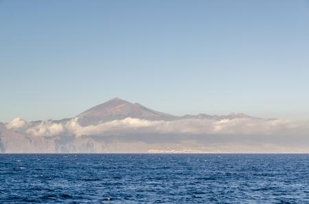 Teide volcano in Tenerife seen a boat in the ocean. Canary islands, Spain
