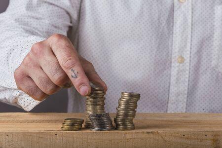 Man mashing stacking euro coins
