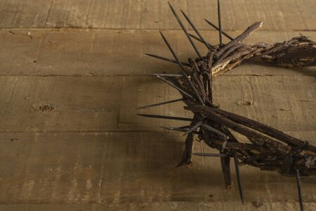 Crown of thorns on wooden background. Easter religious motive commemorating the resurrection of Jesus- Easter