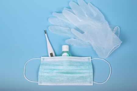Very important personal hygiene and protection products for treatment. Surgical mask, thermometer, disinfecting gel and latex gloves. Coronavirus or covid-19 concept. World virus