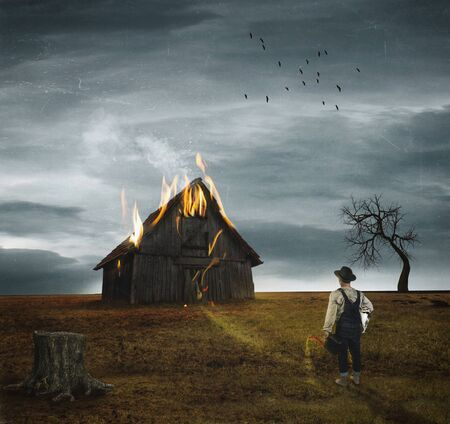 Surreal image of a farm burning as the man watches it burn. Surrealism