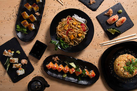 Mixed selection of assorted Japanese food on wooden background. Restaurant menu. 版權商用圖片