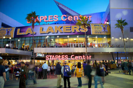 nba: Los Angeles, California - October 26, 2010: Opening game of the 2010-2011 NBA basketball season in Los Angeles. Entrance to the Staples Center, with Los Angeles Laker receiving the Houston Rockets. Editorial