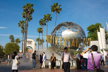 Los Angeles, California, USA - May 21st 2011: Universal Studios Hollywood globe and theme park entrance with visitors enjoying during a sunny day.
