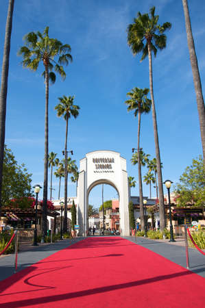 hollywood   california: Los Angeles, California, USA - May 21st 2011: Universal Studios Hollywood theme park entrance with a red carpet leading to the doors during a sunny day. Editorial