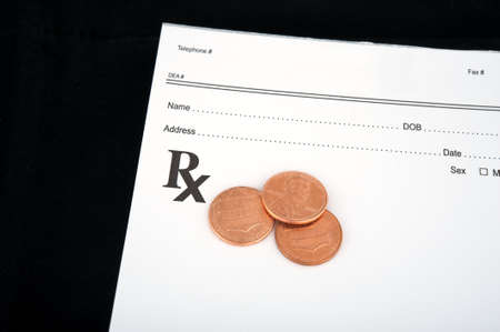 rx: Medica prescription with three cents on top of it Stock Photo