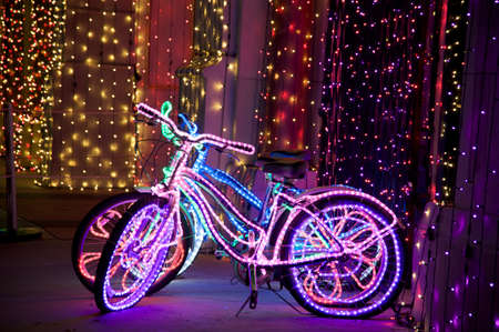 Glowing psychedelic bikes with multicolored Christmas lights 版權商用圖片