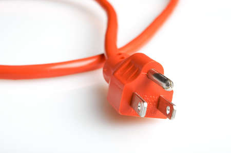 Close up of an orange power plug