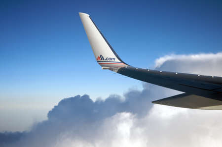 american airlines: Miami, Florida - July 4, 2011: American Airlines plane wing the the website aa.com and clouds in the back. Editorial