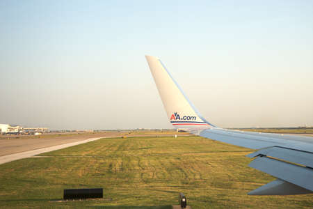 Dallas, Texas - July 4, 2011: American Airlines plane wing about to leave the Dallas Airport Editoriali