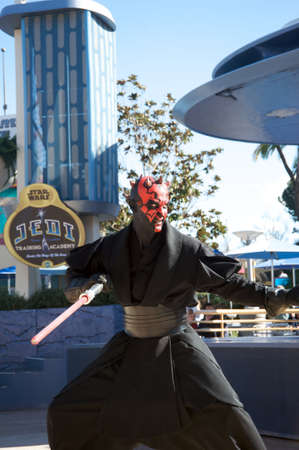 Anaheim, California, USA, February 7, 2010 – Darh Maul at Disneylan's Jedi Training attraction, using his laser saber.