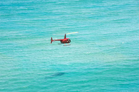 Helicopter over the ocean