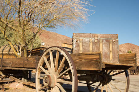 calico: Old carriage with a wooden chest on top of it in Southern California mining Ghost Town Calico