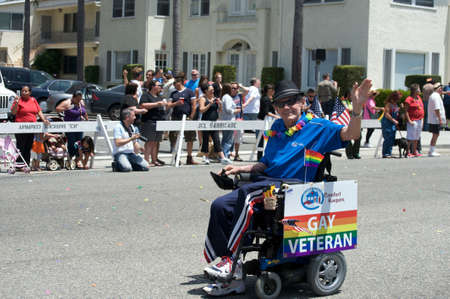 Funny man ridung bike during the Long Beach Lesbian and Gay Pride Parade 2012