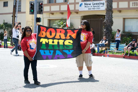 Women holding a Born This Way banner during the Long Beach Lesbian and Gay Pride Parade 2012