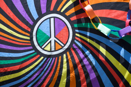 gay parade: Close-up of a flag with the peace sign during the Long Beach Lesbian and Gay Pride Parade 2012