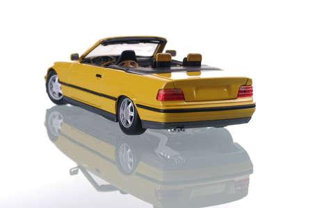yellow car with reflection. Studio shot photo
