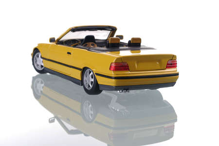 porting: yellow car with reflection. Studio shot